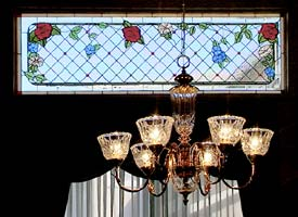 installed stained glass and  chandelier